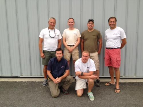 Team members in front of building